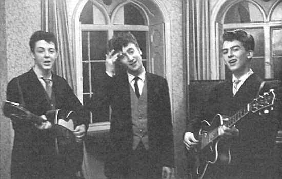 Paul, John and George playing after the wedding of George's brother, Harry