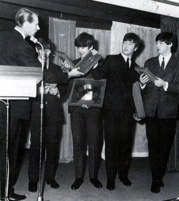 The Beatles are presented with awards