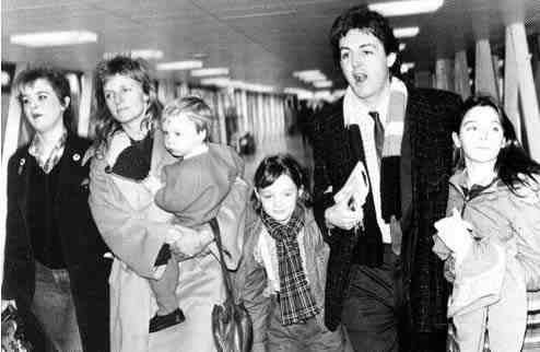 Paul, Linda and their children at the airport
